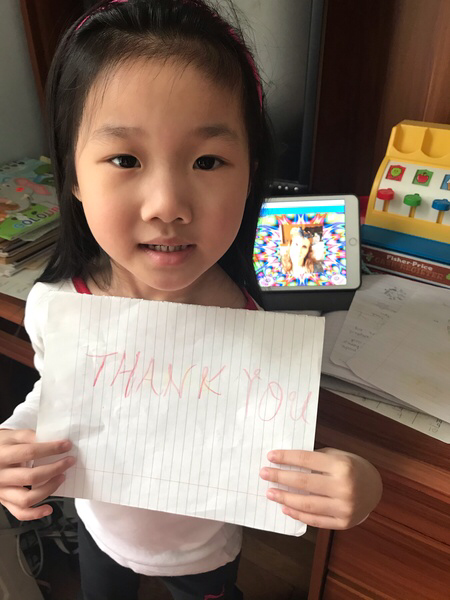 girl holds the work she just completed