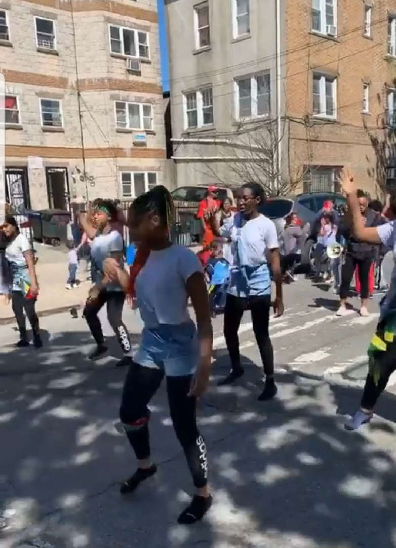 students choreograph a dance in street for multicultural day