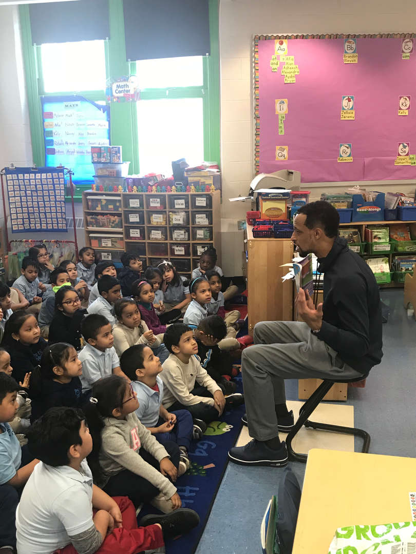author reads to students for world read aloud day