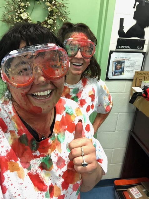 teachers get paint balled for fundraiser for Disney production