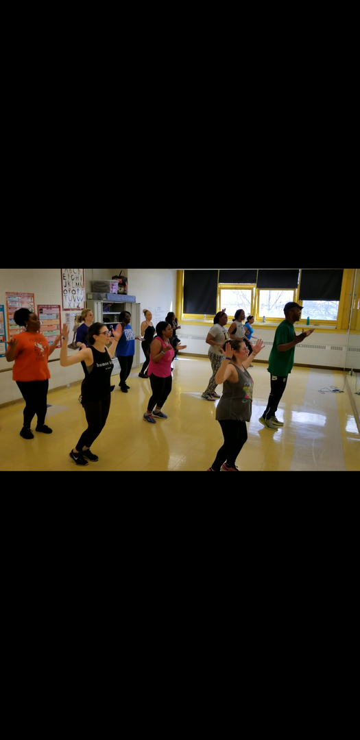 staff excercise in dance room zumba after work