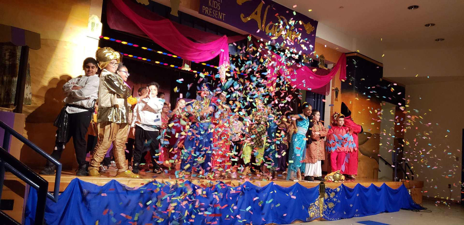students last curtain bow with confetti in air