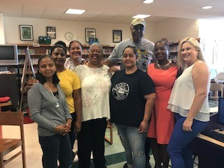 visitor Rodney Pride poses with 268's pta members and staff
