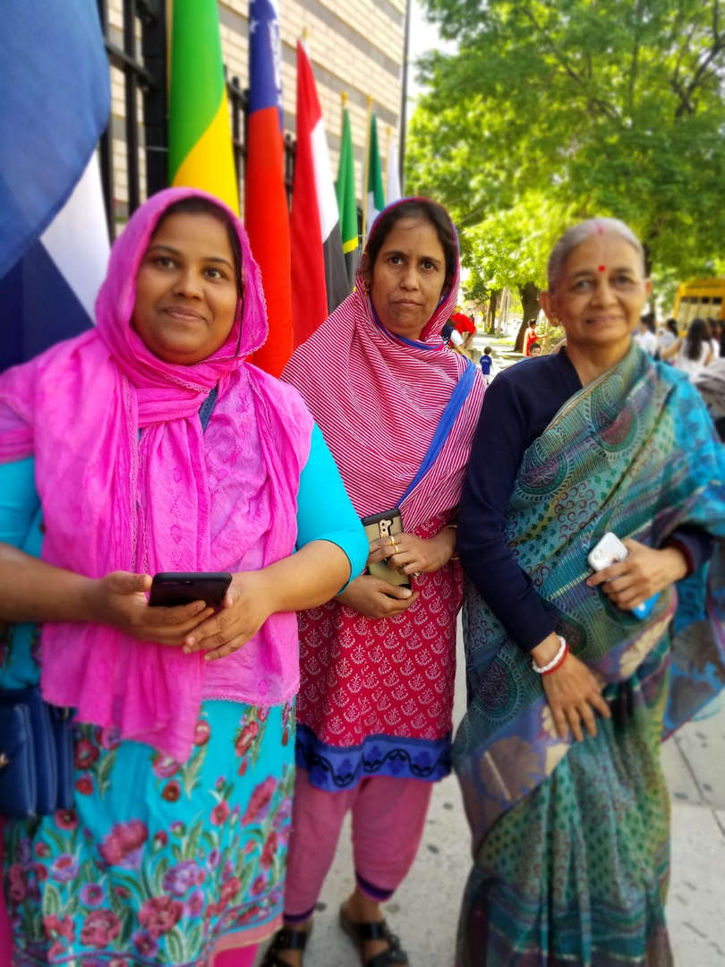 three ladies pose from India in cultural garb