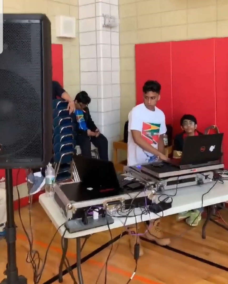 young men on audio equipment playing music for event