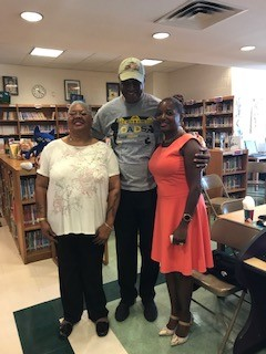 visitor Rodney Pride poses with Principal Stewart and Parent Cooridinator Ms. Simms