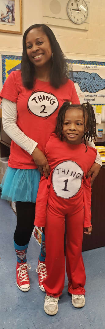 Woman and child dressed in red with shirt that says thing one