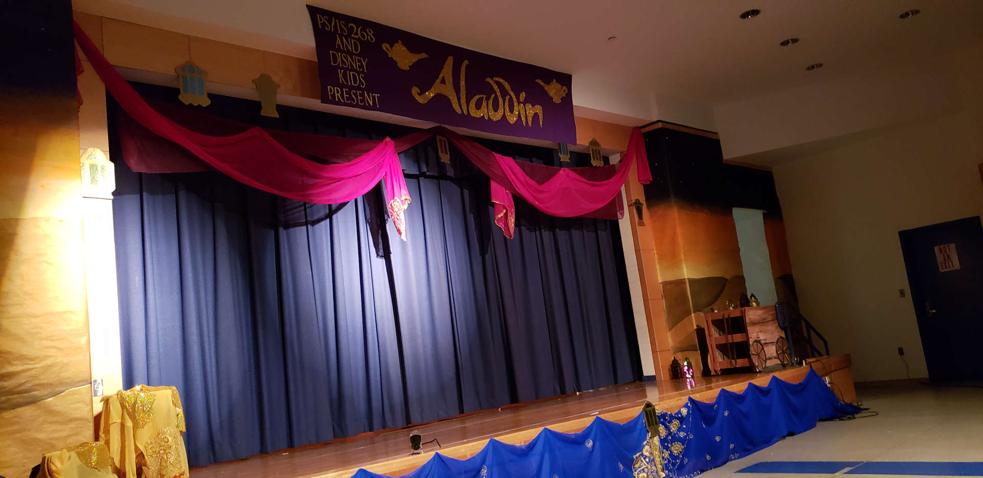 stage is decorated to welcome parents to Agrabah