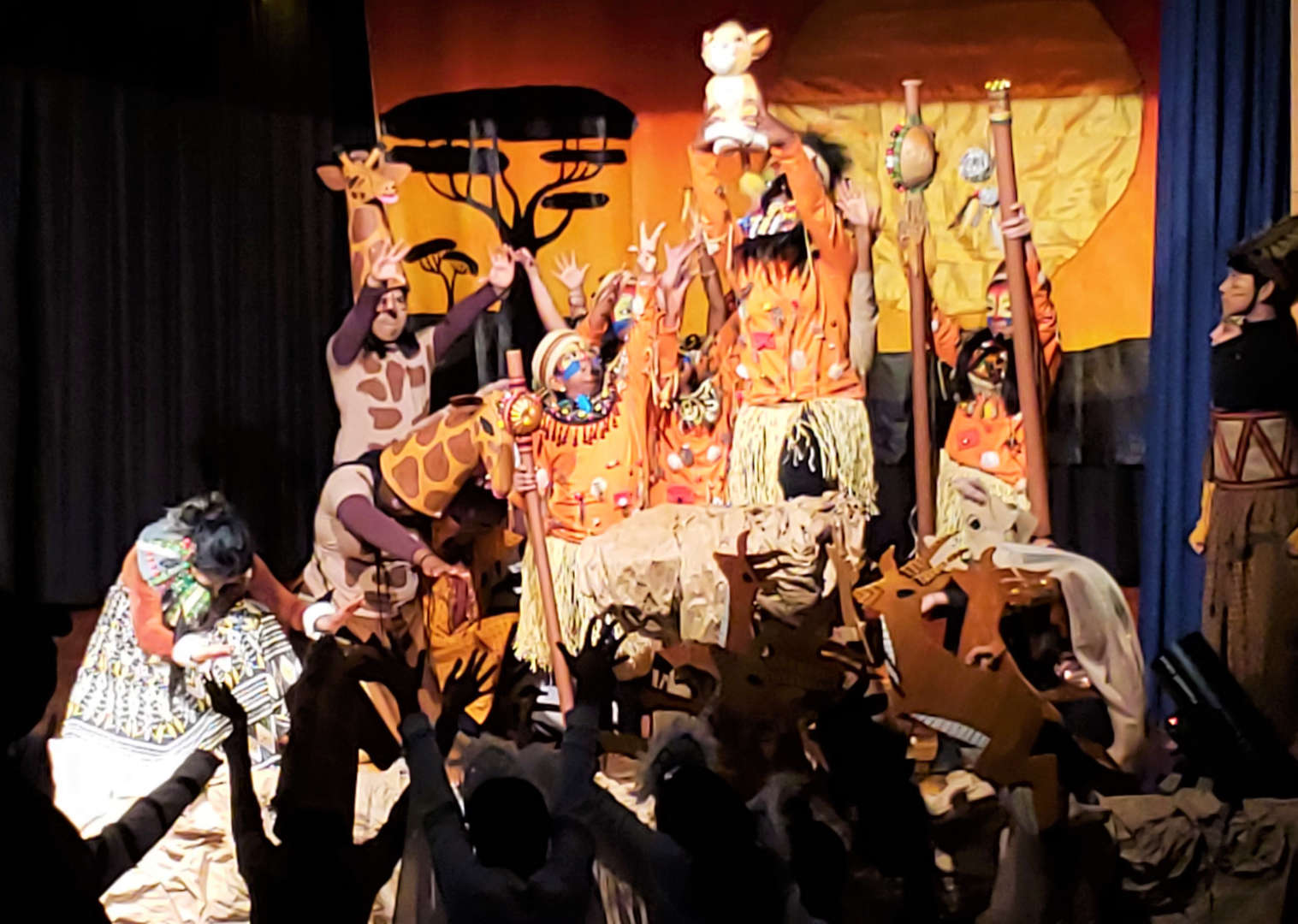 students pose as animals in Lion King welcoming new king baby simba