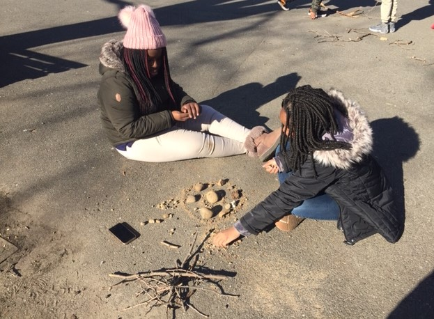students work together to create art project using branches