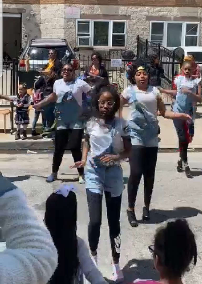 students dance in street for multicultural day