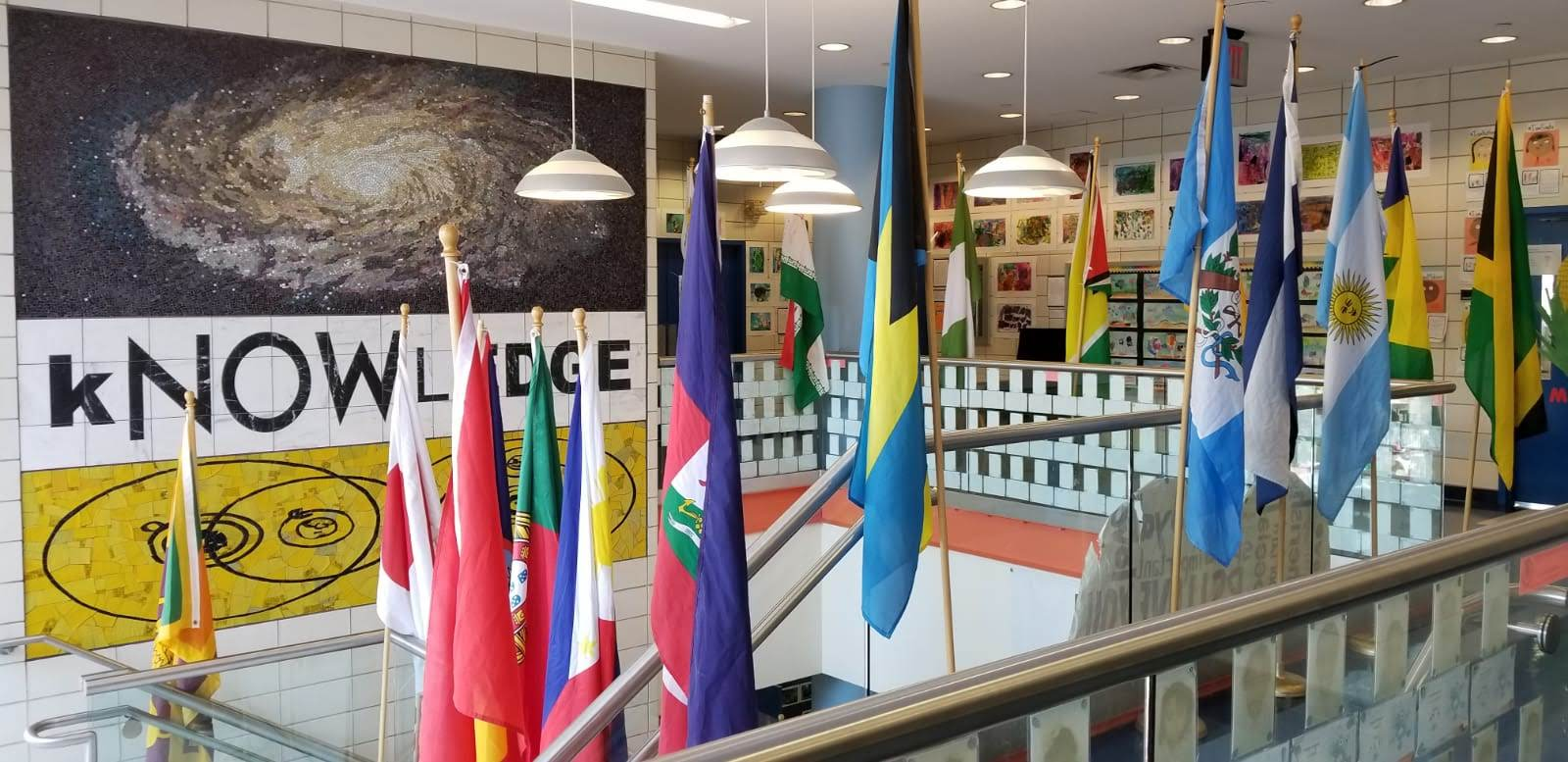 flags in school representing different cultures in community