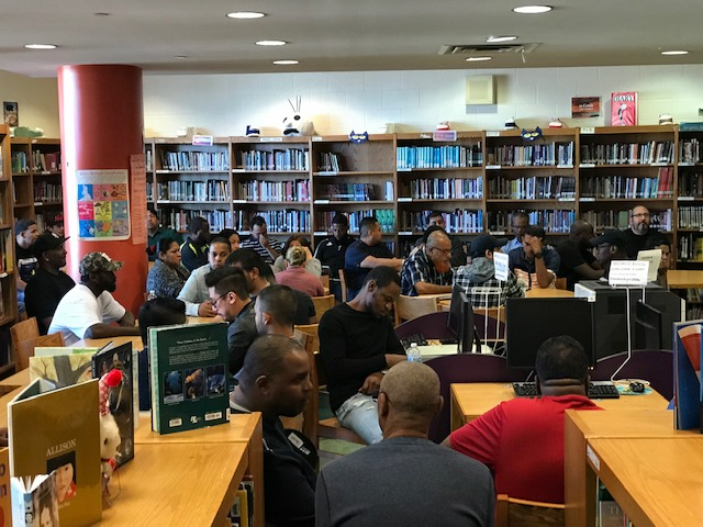 fathers of students meet in library
