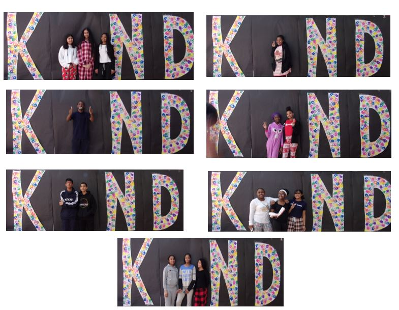 students pose as the letter i in the word kind