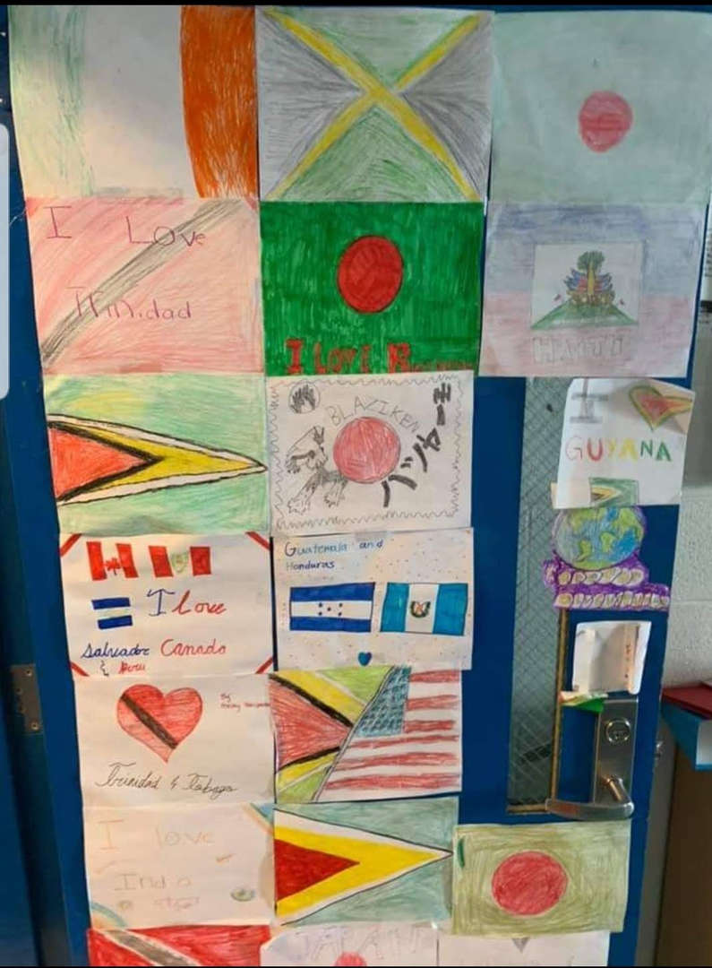 flags from japan, Isreal, Costa Rica and USA decorate this classroom door