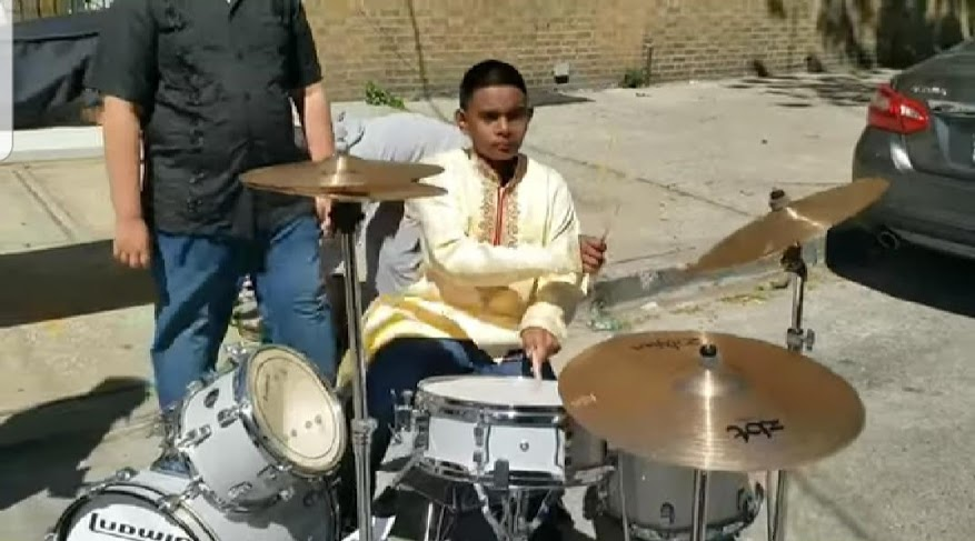 student plays drums