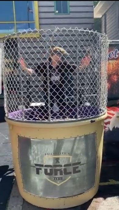 target gets hit in dunk tank and teacher goes in water