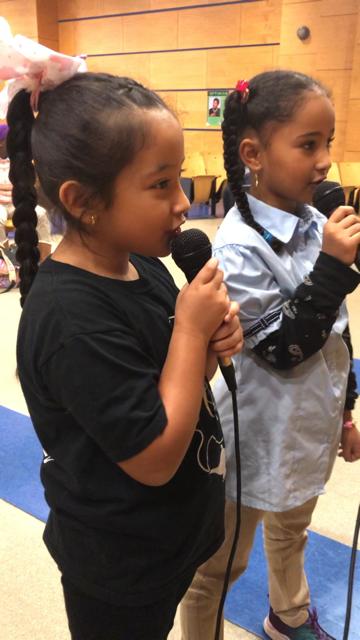students sing karoke