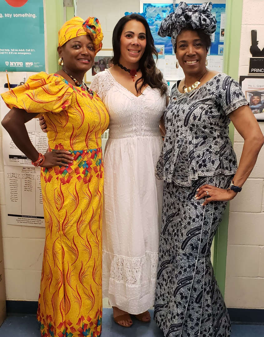 three ladies dressed in cultural attire representing Africa and Puerto Rico