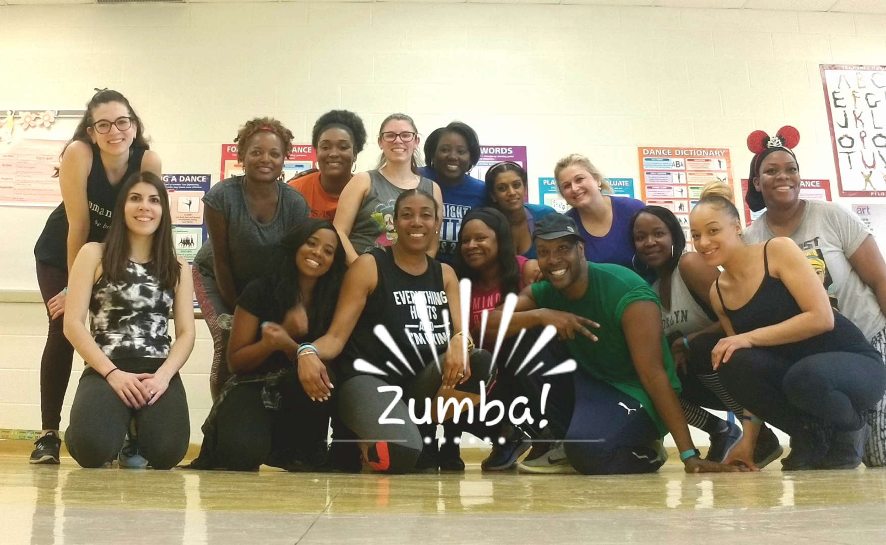 staff poses after zumba class