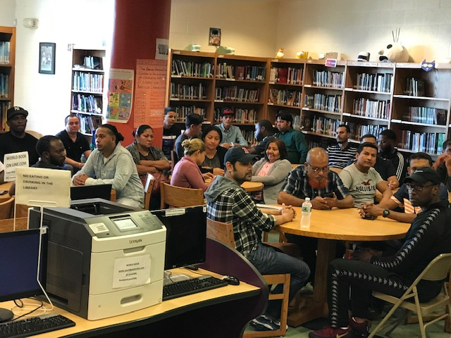 fathers of students gather in library