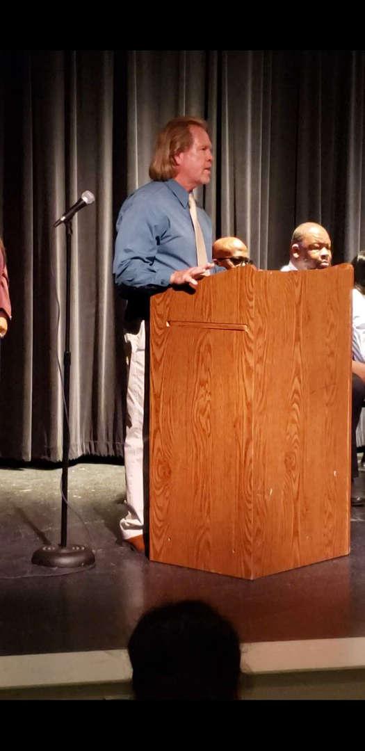 Adult at podium