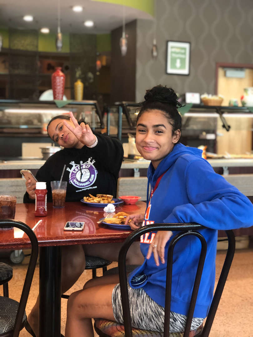 Two students eating in a college cafeteria
