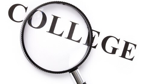 Magnifying glass over the word college