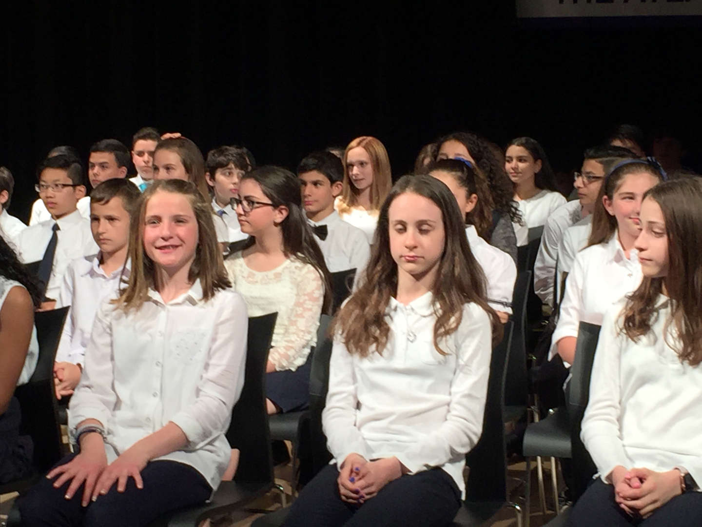Middle School students at ceremony being inducted into the National Junior Honors Society