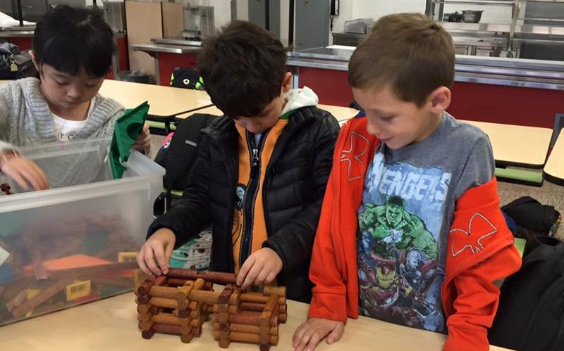 Students participating in PS/IS 48's after school program by building with log blocks