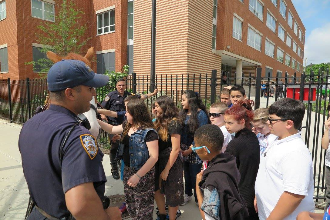 Police officers and students participating in Too Good for Drugs program