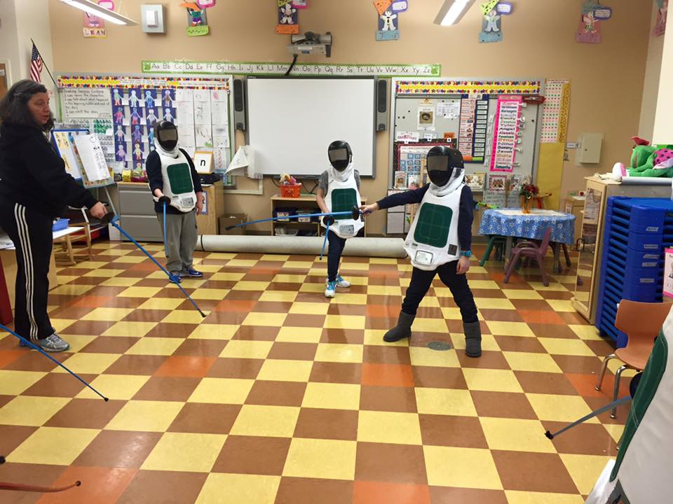 After school students participating in the fencing program