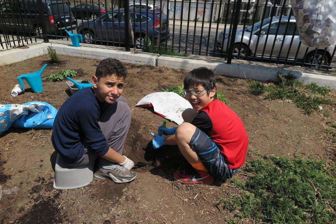 Students planting in our Community Garden as part of our Grow to Learn Garden program