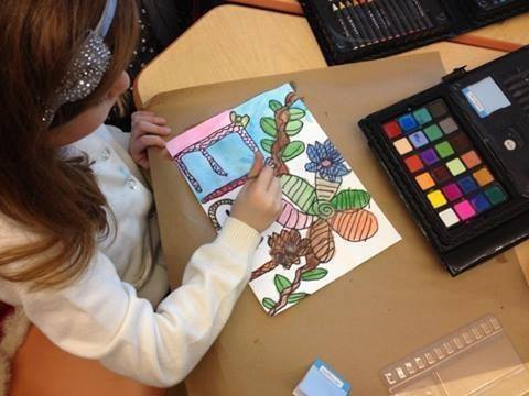 Student in after school art program participating in drawing