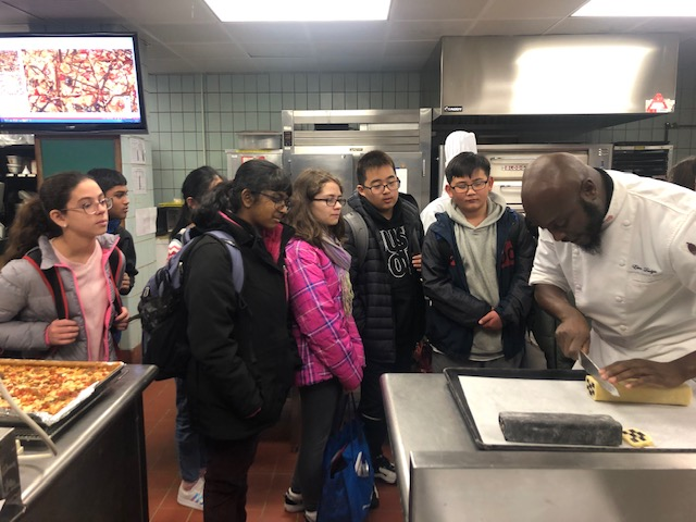 In the kitchen with the Chef and students learning how to make holiday cookies.