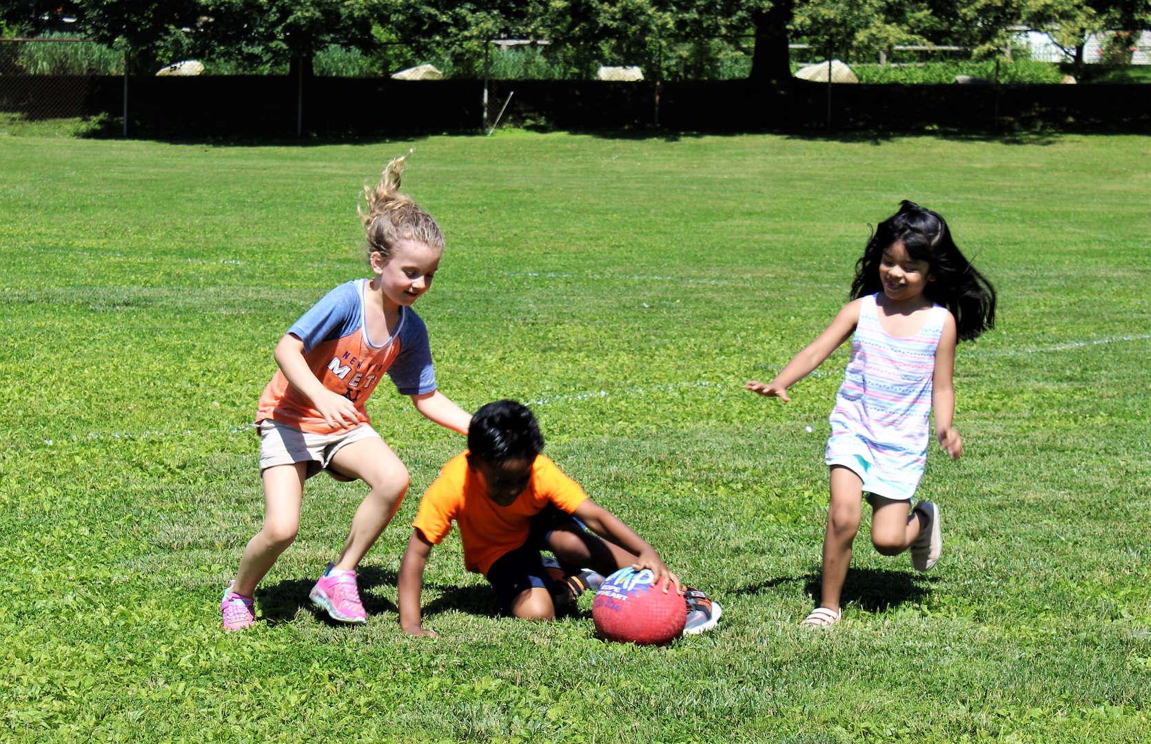 Children running after a ball.