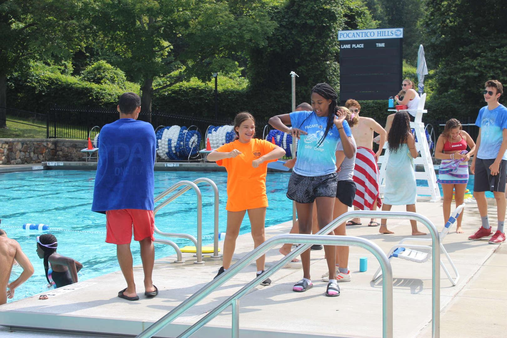 Dancing at the school pool.