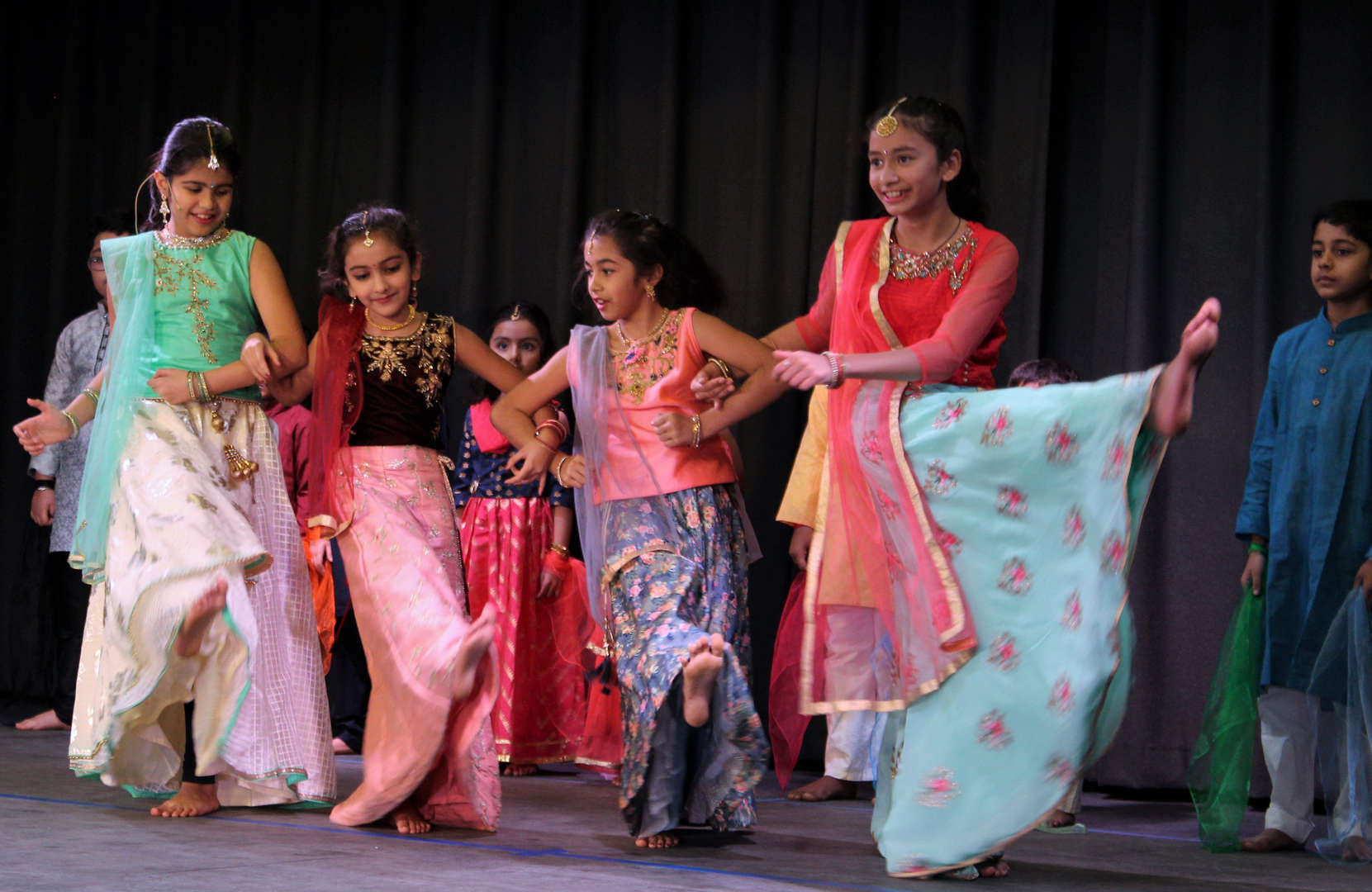 Students give a performance of Indian dancing at One World Evening.