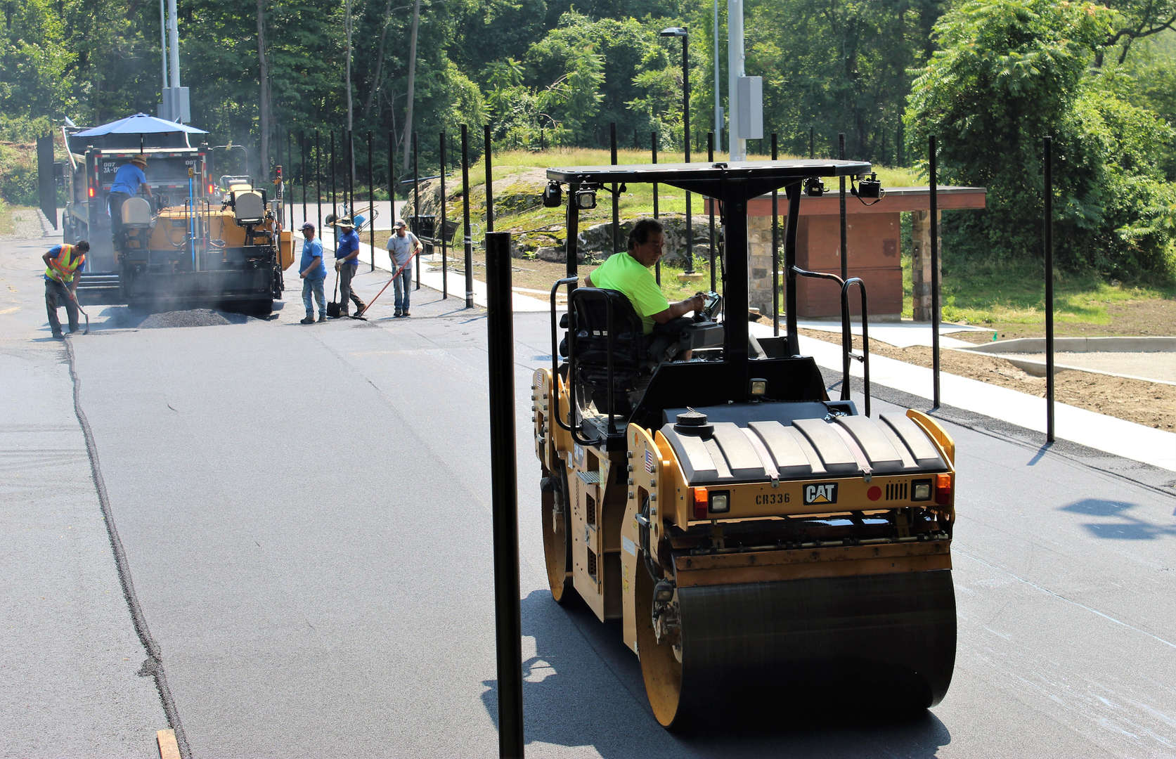Photo of workers paving the new tennis courts.