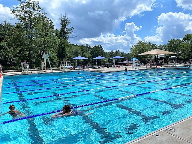 Families swim in the pool at Pocantico Hills School.