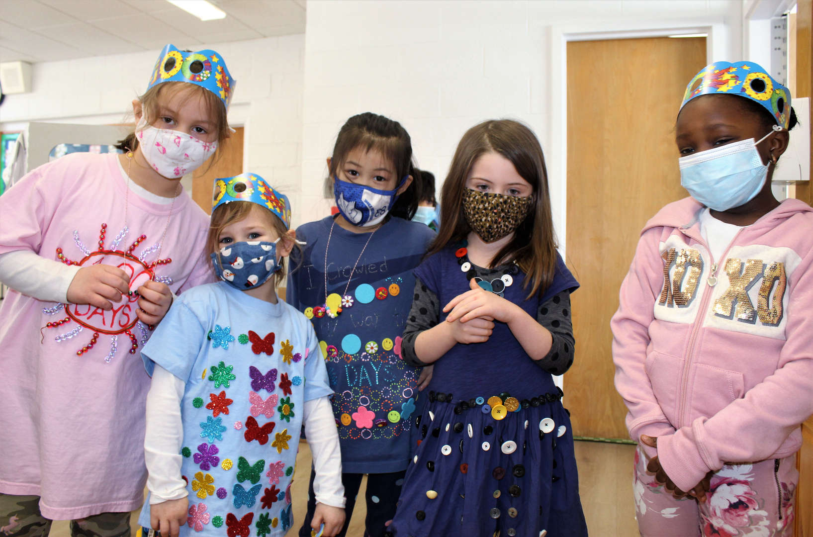 Kindergarteners wearing special shirts for the 100th day of school.