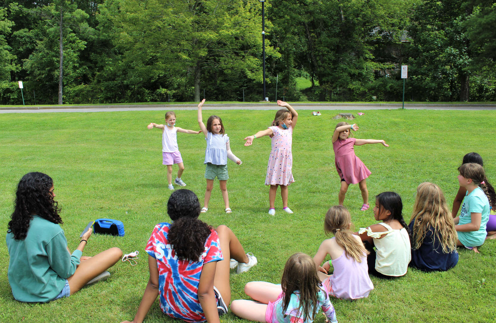 Young campers practice their routine in advance of the talent show.