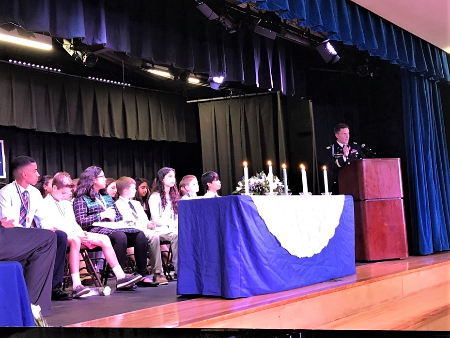Photo of students being inducted into the National Junior Honor Society.