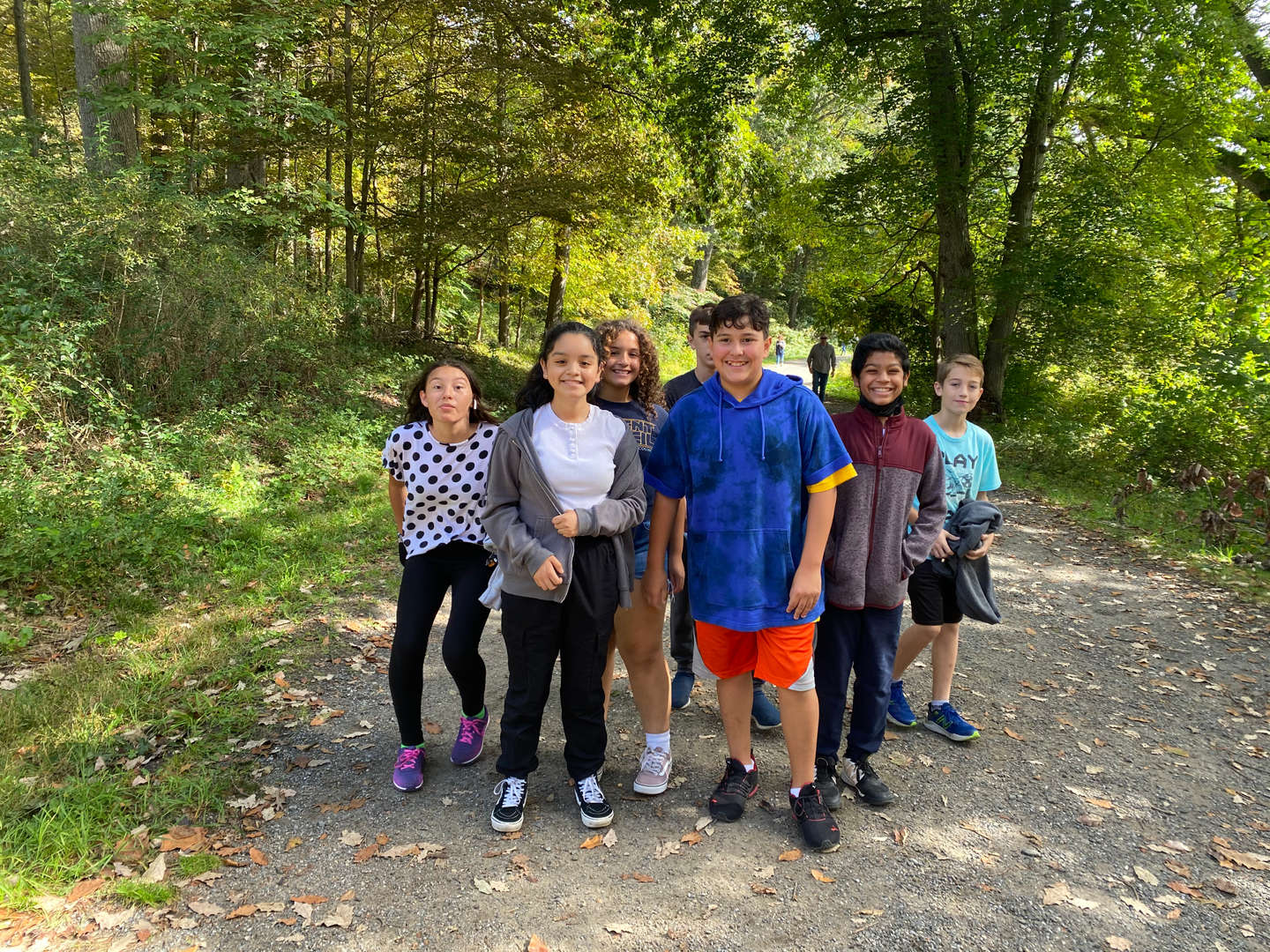 A group of students walks on a trail at the Rockefeller State Park Preserve's Swan Lake.
