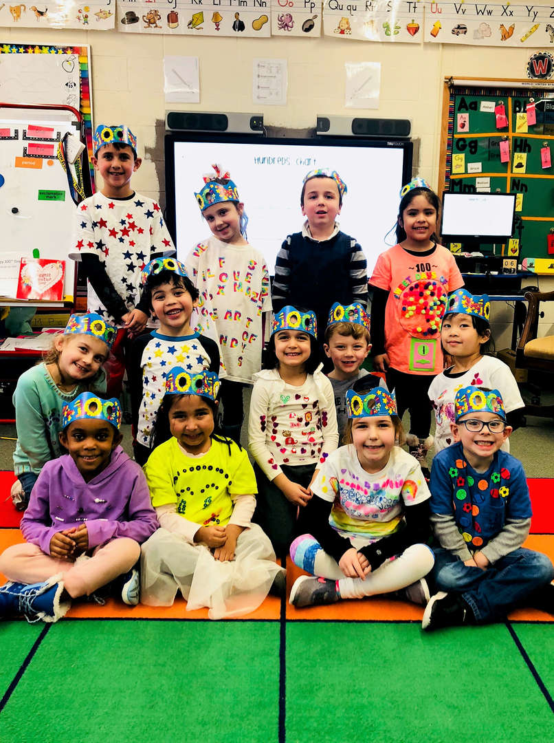 A kindergarten class poses for a photo on the 100th day of school.