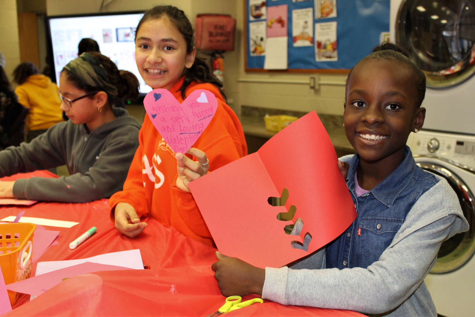 Two female students make Valentine's Day cards.