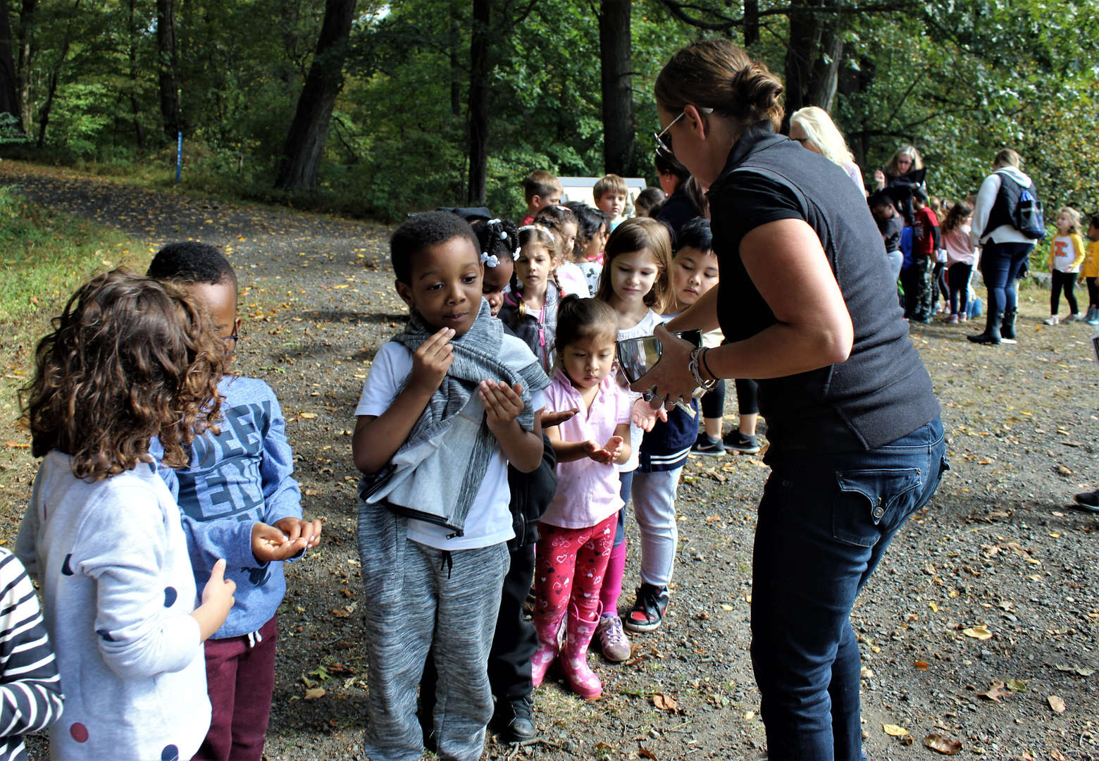 Children sample maple syrup jelly beans at one of the educational stations.