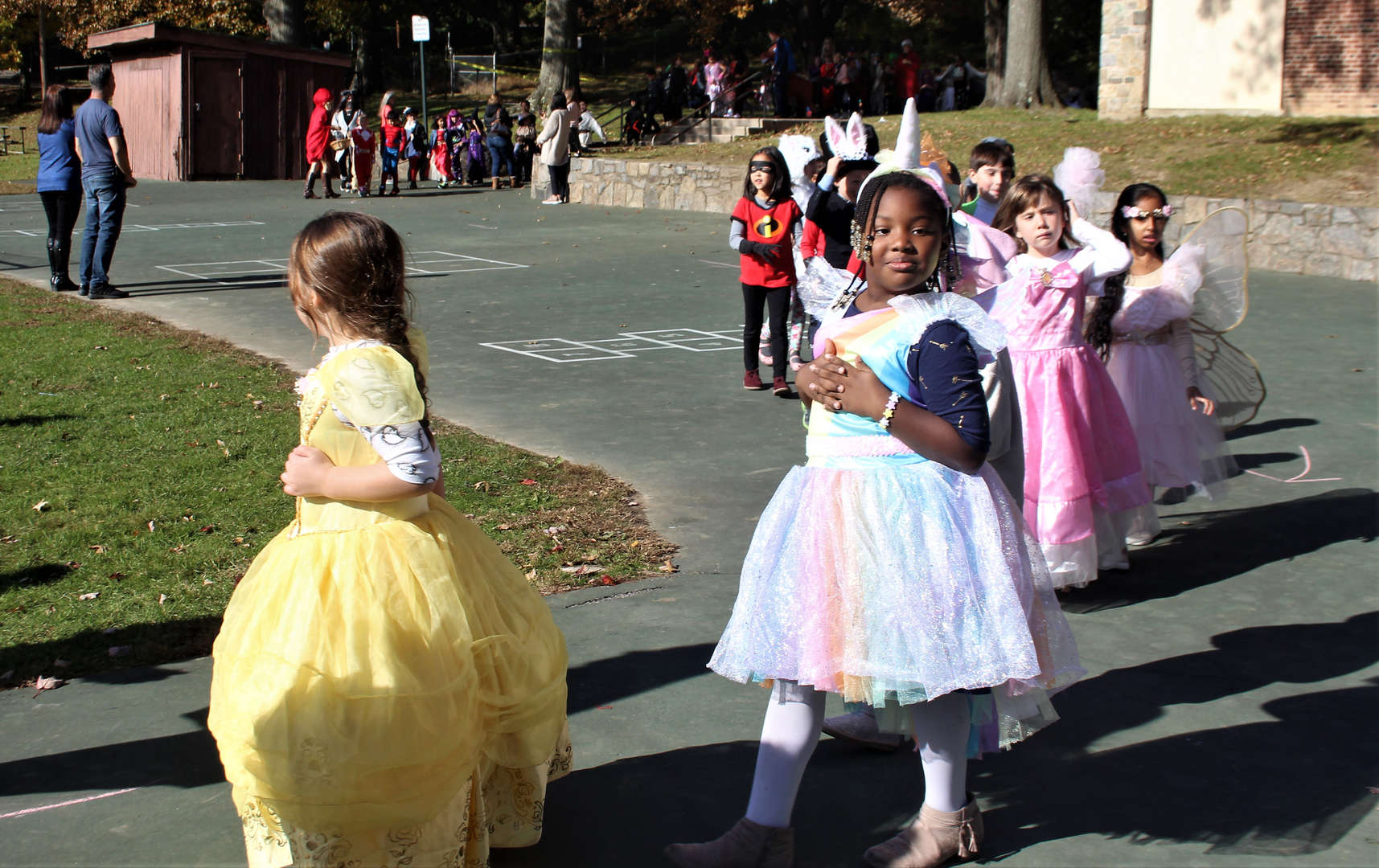 Costumed students walking in a Halloween parade.