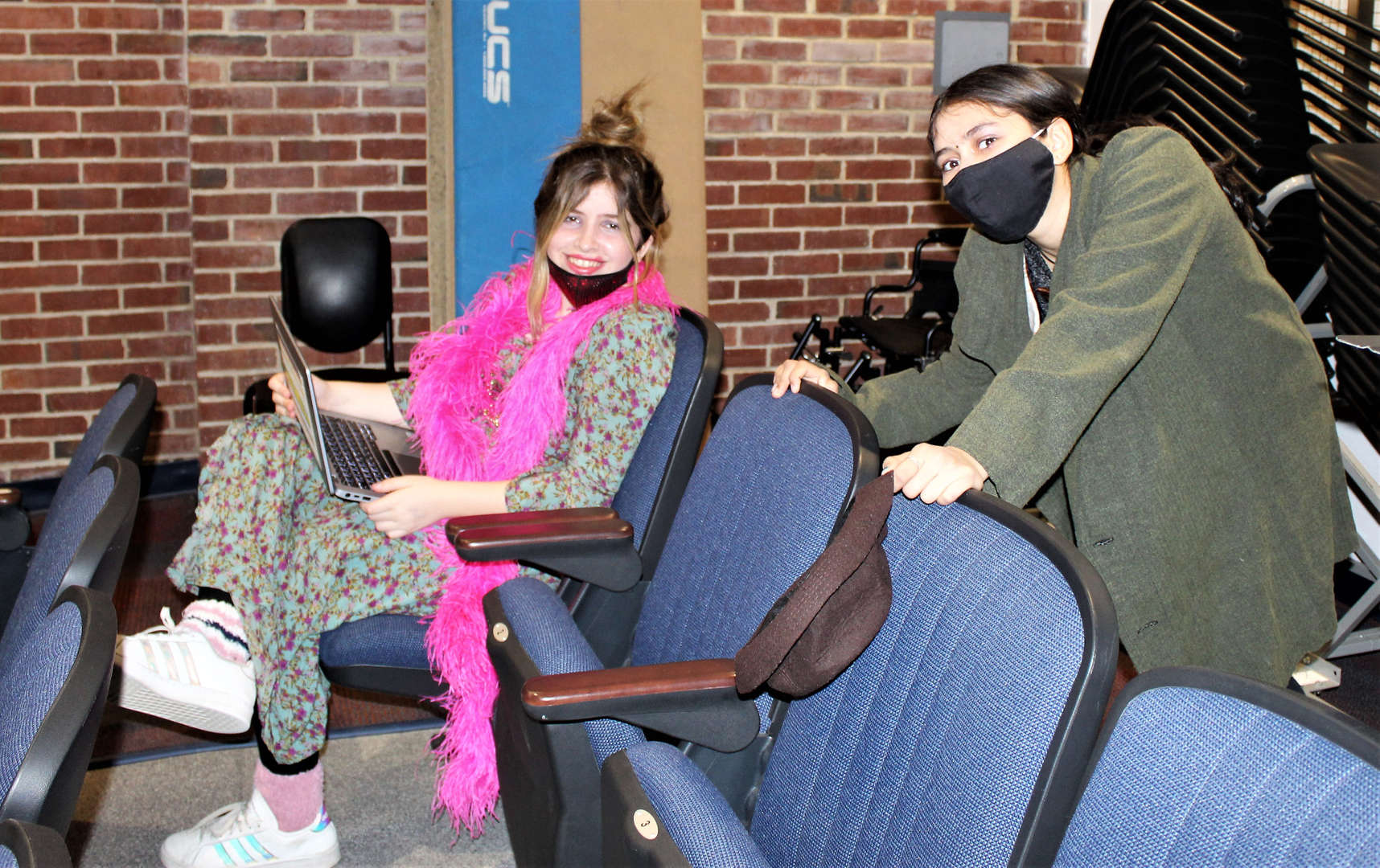 Two female students in Annie JR. prepare for a performance.