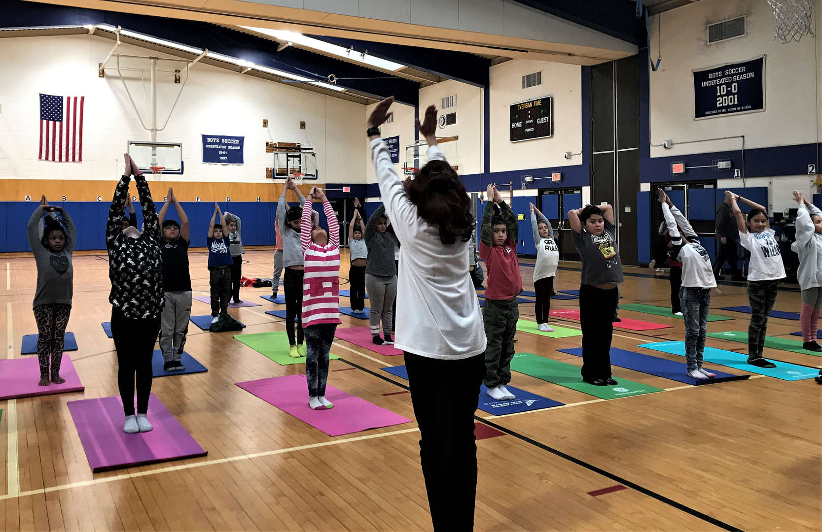 A class practices yoga moves during a recent unit.